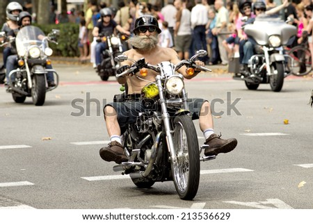 BARCELONA - JULY, 6: Harley-Davidson Motorcycles driving during the Barcelona Harley Days event on the city streets, July 6, 2014 in Barcelona, Spain - stock photo