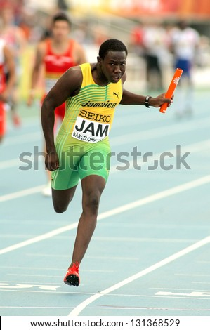 BARCELONA - JULY, 13: Jazeel Murphy of Jamaica sprinting during the 20th World Junior Athletics Championships at the Olympic Stadium on July 13, 2012 in Barcelona, Spain - stock photo