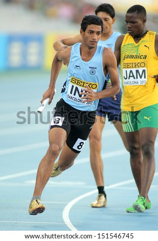 BARCELONA - JULY, 14: Jeevan Karekoppa Suresh of India competes on 4X400 Relay of the 20th World Junior Athletics Championships at the Olympic Stadium on July 14, 2012 in Barcelona, Spain - stock photo
