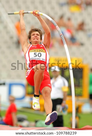BARCELONA - JULY 10: Lukas Wirth of Austria during Pole Vault event of the 20th World Junior Athletics Championships at the Olympic Stadium on July 10, 2012 in Barcelona, Spain - stock photo