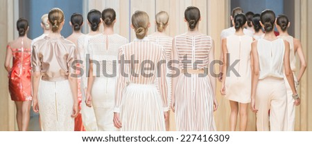 BARCELONA - JULY 01: models walking on the Justicia Ruano catwalk during the 080 Barcelona Fashion runway Spring/Summer 2015 on July 01, 2014 in Barcelona, Spain.  - stock photo
