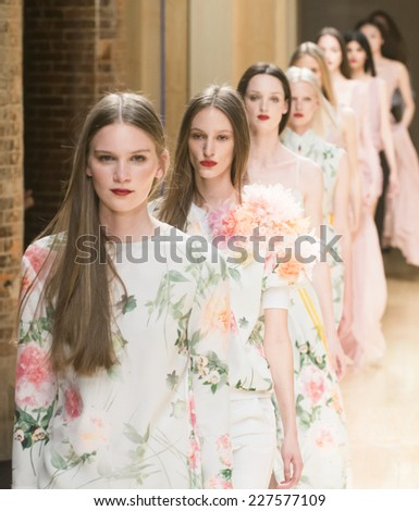 BARCELONA - JULY 01: models walking on the Menchen Tomas catwalk during the 080 Barcelona Fashion runway Spring/Summer 2015 on July 01, 2014 in Barcelona, Spain.  - stock photo