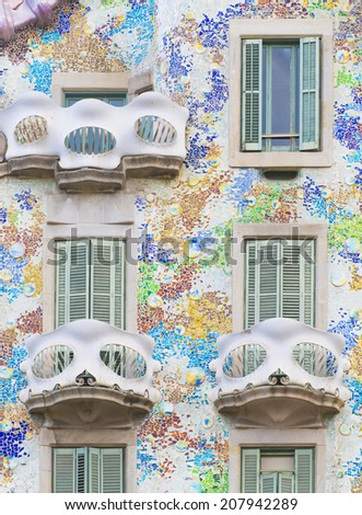BARCELONA - JULY 29: part of the Casa Batllo facade designed by Antoni Gaudi on July 29, 2014, Barcelona, Spain.  - stock photo
