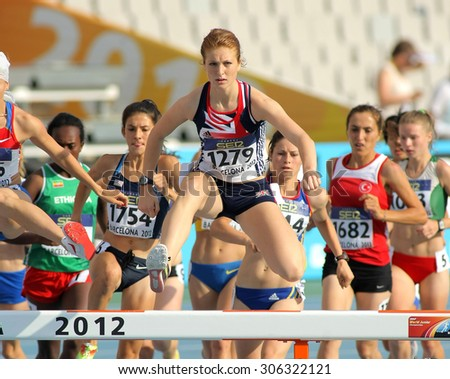 BARCELONA - JULY, 10: Pippa Woolven of Great Britain in action on 3000 meters Steeplechase of the 20th World Junior Athletics Championships at the Olympic Stadium on July 10, 2012 in Barcelona, Spain - stock photo