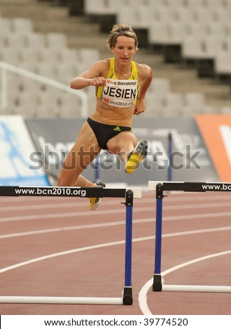 BARCELONA JULY 25: Polish athlete Anna Jesien jump in her women's 400 meters hurdles at the Meeting Ciutat de Barcelona athletics event on July 25, 2009 in Barcelona, Spain. - stock photo