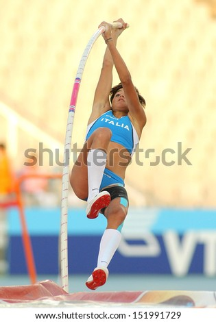 BARCELONA - JULY, 14: Roberta Bruni of Italy in action during Pole Vault Event of the 20th World Junior Athletics Championships at the Olympic Stadium on July 14, 2012 in Barcelona, Spain - stock photo