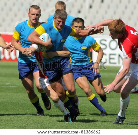 BARCELONA - JULY 9: Sergei Monastyrov of Ukraine drives the ball during the match of Rugby7 European Championship between Ukraine  and Wales at the Olympic Stadium in Barcelona, on July 9, 2011