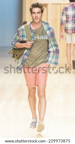BARCELONA - JULY 01: spanish model Jon Kortajarena walks on the Desigual catwalk during the 080 Barcelona Fashion runway Spring/Summer 2015 on July 01, 2014 in Barcelona, Spain.  - stock photo