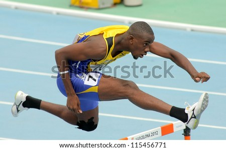 BARCELONA - JULY, 11: Tramaine Maloney of Barbados during 400m hurdles event of the 20th World Junior Athletics Championships at the Olympic Stadium on July 11, 2012 in Barcelona, Spain - stock photo