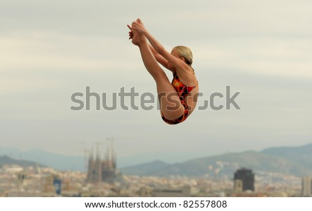 BARCELONA - JULY 24: unidentified diving athlete in action during a competition  of Barcelona diving trophy at Monjuich swimming pool July 24, 2011 in Barcelona, Spain - stock photo
