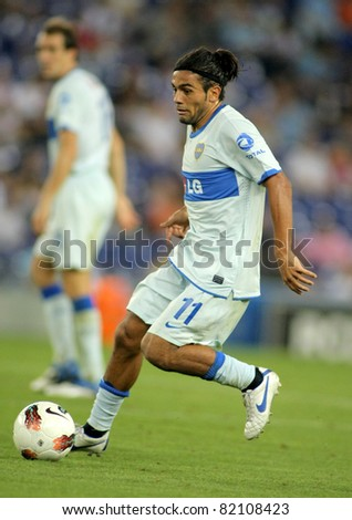 BARCELONA - JULY 28: Walter Erviti of Boca Juniors in action during a friendly match against RCD Espanyol at the Estadi Cornella on July 28, 2011 in Barcelona, Spain