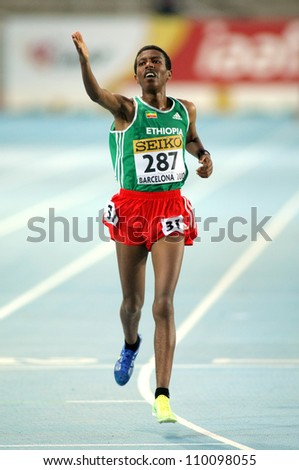 BARCELONA - JULY 10: Yigrem Demelash of Ethiopia during 10000 Metres event of the 20th World Junior Athletics Championships at the Olympic Stadium on July 10, 2012 in Barcelona, Spain - stock photo
