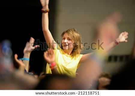 BARCELONA - JUN 14: A girl watches a concert at Sonar Festival on June 14, 2014 in Barcelona, Spain. - stock photo