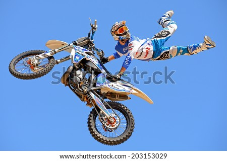 BARCELONA - JUN 28: A professional rider at the FMX (Freestyle Motocross) competition at LKXA Extreme Sports Barcelona Games on June 28, 2014 in Barcelona, Spain. - stock photo