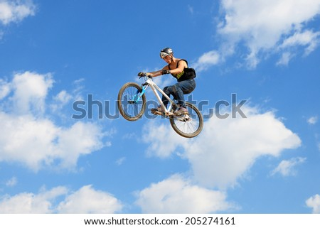 BARCELONA - JUN 28: A professional rider at the MTB (Mountain Biking) competition on the Dirt Track at LKXA Extreme Sports Barcelona Games on June 28, 2014 in Barcelona, Spain.