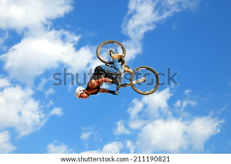 BARCELONA - JUN 28: A professional rider at the MTB (Mountain Biking) competition on the Dirt Track at LKXA Extreme Sports Barcelona Games on June 28, 2014 in Barcelona, Spain. - stock photo