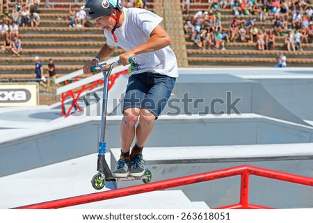 BARCELONA - JUN 28: A professional rider at the Scooter Pak competition on the Central Park at LKXA Extreme Sports Barcelona Games on June 28, 2014 in Barcelona, Spain. - stock photo