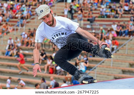 BARCELONA - JUN 28: A professional skater at the Inline skating jumps competition at LKXA Extreme Sports Barcelona Games on June 28, 2014 in Barcelona, Spain. - stock photo