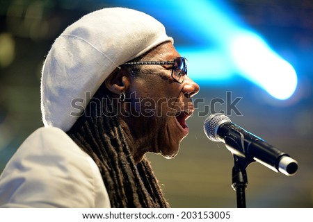 BARCELONA - JUN 14: Nile Rodgers, famous producer of David Bowie, Duran Duran, Madonna, and more recently, French house duo Daft Punk, performs at Sonar Festival on June 14, 2014 in Barcelona, Spain. - stock photo