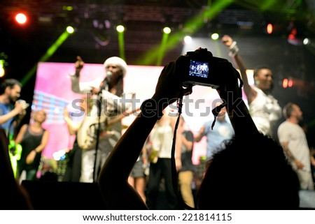 BARCELONA - JUN 14: People from the audience recording and taking pictures with their cameras at Chic featuring Nile Rodgers (band) show at Sonar Festival on June 14, 2014 in Barcelona, Spain. - stock photo