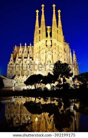 BARCELONA - JUN 4: Sagrada Familia at night on June 4, 2015 in Barcelona, Spain. The UNESCO World Heritage Site, still under construction, was designed by Antoni Gaudi and started in 1882. - stock photo