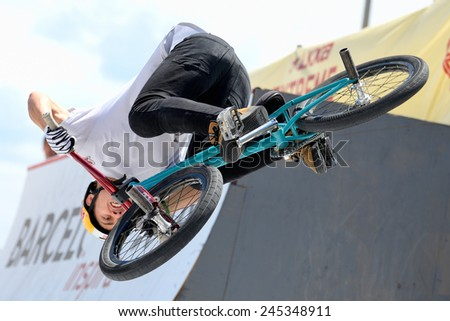 BARCELONA - JUNE 28: A professional rider at the MTB (Mountain Biking) competition on the Dirt Track at LKXA Extreme Sports Barcelona Games on June 28, 2014 in Barcelona, Spain.