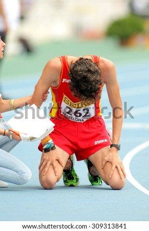 BARCELONA - JUNE, 13: Alvaro Martin of Spain when finished 10000 metres race walk event of of the 20th World Junior Athletics Championships at the Olympic Stadium on July 13, 2012 in Barcelona, Spain - stock photo