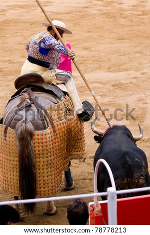 BARCELONA - JUNE 6: An unidentified picador, horsemen who jabs the bull with a lance. June 6, 2010 in Barcelona, Spain. Bullfight, Spanish tradition where a bullfighter kills a bull. - stock photo