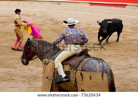 """BARCELONA - JUNE 6: Bullfight, a typical Spanish tradition. In the picture, a """"Picador"""", horsemen in a Spanish bullfight who jabs the bull with a lance June 6, 2010 in Barcelona (Spain). - stock photo"""