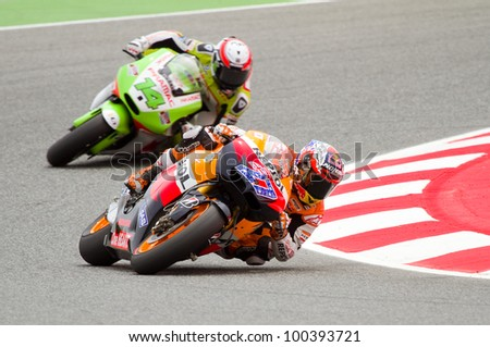 BARCELONA - JUNE 4: Casey Stoner (27) of Repsol Honda team races at Qualifying Session of Moto GP Grand Prix of Catalunya on June 4, 2011 in Barcelona, Spain.
