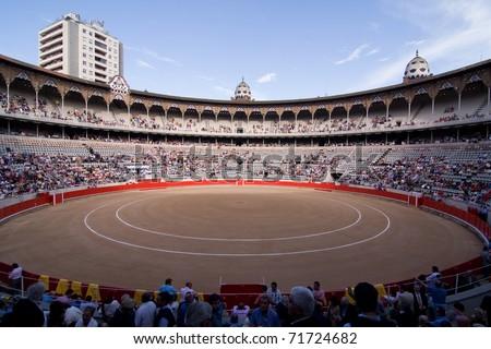 "BARCELONA - JUNE 6: ""Corrida"" (bullfighting) of bulls, typical Spanish tradition where a torero (bullfighter) kills a bull. In the picture, the Plaza Monumental. June 6, 2010 in Barcelona (Spain). - stock photo"