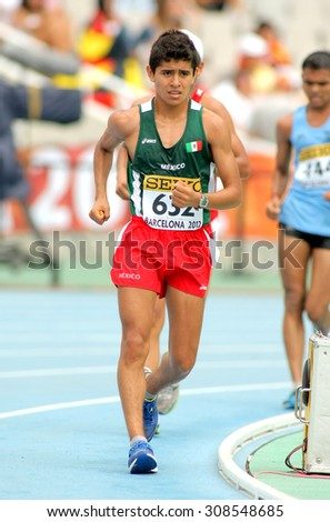 BARCELONA - JUNE, 13: Erwin Gonzalez of Mexico during 10000 metres race walk event of of the 20th World Junior Athletics Championships at the Olympic Stadium on July 13, 2012 in Barcelona, Spain - stock photo