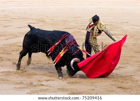 """BARCELONA - JUNE 6: Finito de Cordoba in action during a """"corrida de toros"""", typical Spanish tradition where a """"torero"""" kills a bull. June 6, 2010 in Barcelona (Spain). - stock photo"""
