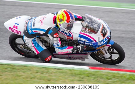BARCELONA - JUNE 5: Maverick Vinales (25) of Blusens SMX Paris Hilton team racing at Moto 125 Grand Prix of Catalunya, on June 5, 2011 in Barcelona, Spain. - stock photo