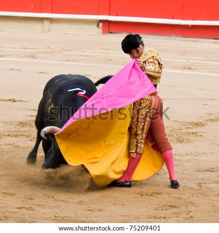 "BARCELONA - JUNE 6: Morante de la Puebla in action during a ""corrida de toros"", typical Spanish tradition where a ""torero"" kills a bull. June 6, 2010 in Barcelona (Spain). - stock photo"