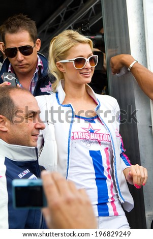 BARCELONA - JUNE 5: Paris Hilton visits Catalunya Circuit for the Moto GP Grand Prix weekend, on June 5, 2011 in Barcelona, Spain. - stock photo