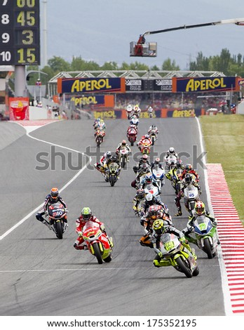 BARCELONA - JUNE 3: Some motorcycle riders compete at the race of Moto 2 Grand Prix of Catalunya, on June 3, 2012 in Barcelona, Spain. The winner was Andrea Iannone.