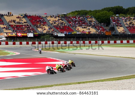 BARCELONA - JUNE 4: Some unidentified riders racing at Qualifying Session of Moto 125 Grand Prix of Catalunya, on June 4, 2011 in Barcelona, Spain. - stock photo