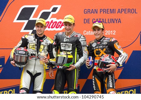 BARCELONA - JUNE 3: Thomas Luthi (2nd), Andrea Iannone (1st) and Marc Marquez (3rd) (L-R) in the podium after the race of Moto2 Grand Prix of Catalunya, on June 3, 2012 in Barcelona, Spain. - stock photo