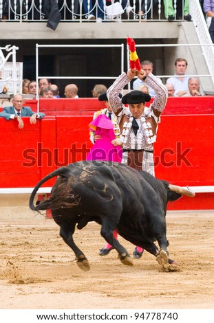 BARCELONA - JUNE 6: Unidentified Bullfighter perform during a corrida de toros or bullfight, typical Spanish tradition where a torero or bullfighter kills a bull on June 6, 2010 in Barcelona, Spain. - stock photo