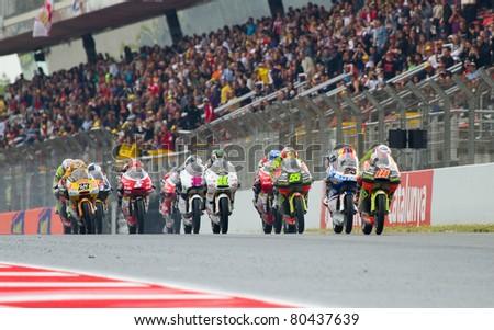 BARCELONA - JUNE 5: Unidentified riders racing at the race of Moto 125 Grand Prix of Catalunya, on June 5, 2011 in Barcelona, Spain. - stock photo