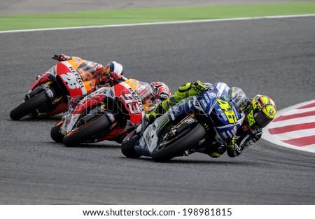BARCELONA - JUNE 15: Valentino Rossi, Marc Marquez and Dani Pedrosa at GP CATALUNYA MOTO GP at Catalunya Circuit on June 15, 2014 in Barcelona, Spain.  - stock photo