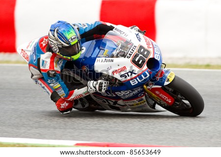 BARCELONA - JUNE 4: Yonny Hernandez of Blusens STX team racing at Qualifying Session of Moto2 Grand Prix of Catalunya, on June 4, 2011 in Barcelona, Spain.