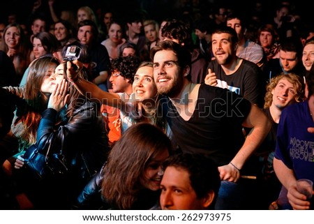 BARCELONA - MAR 18: A couple from the crowd takes a selfie with a Gopro camera at Bikini stage on March 18, 2015 in Barcelona, Spain. - stock photo