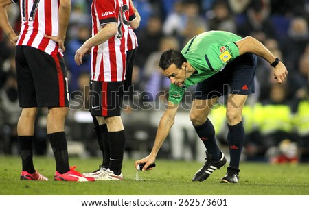 BARCELONA - MAR, 4: Referee Juan Martinez Munuera marks kick off positions with a Vanishing spray during a Spanish League match at the Estadi Cornella on March 4, 2015 in Barcelona, Spain - stock photo