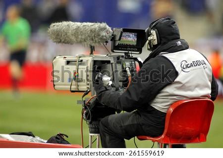BARCELONA - 4, MAR: Television camera broadcasting football spanish league match at the Estadi Cornella on March 4, 2015 in Barcelona, Spain - stock photo