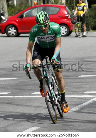 BARCELONA - MARCH, 29: Carlos Barbero of Caja Rural Team rides during the Tour of Catalonia cycling race through the streets of Monjuich mountain in Barcelona on March 29, 2015 - stock photo