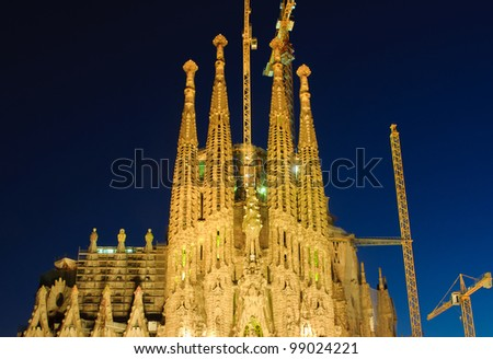 BARCELONA - MARCH 12: Detail of la Sagrada Familia illuminated at night, cathedral designed by Antoni Gaudi that is being build since 1882, on March 12, 2012, Barcelona, Spain. - stock photo