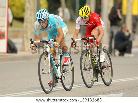 BARCELONA - MARCH, 24: Dyachenko(L) of Astana and Rudy Molard(R) of Cofidis rides during the Tour of Catalonia cycling race through the streets of Monjuich mountain in Barcelona on March 24, 2013 - stock photo