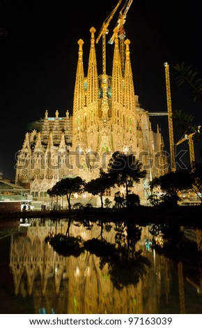 BARCELONA – MARCH 8: La Sagrada Familia illuminated at night, cathedral designed by Antoni Gaudi that is being build since 1882, on March 8, 2012, Barcelona, Spain. - stock photo
